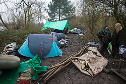 Harefield, UK. 14 January, 2020. The belongings of Stop HS2 activists at a protection camp close to Harvil Road from which enforcement agents working on behalf of HS2 are attempting to remove them. Part of the nearby Colne Valley protection camp was evicted by bailiffs last week. 108 ancient woodlands are set to be destroyed by the high-speed rail link and further destruction of trees for HS2 in the Harvil Road area is believed to be imminent.