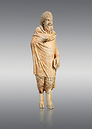Marble statue of Pan found in Sparta, Pelopenese, 1st Cent AD copy of 4th Cent BC Greek original. Athens Archaeological Museum Cat No 252. Against grey<br /> <br /> Pan, the goat footed god wears an animal pelt from which protrude only his jhairy legs. In his left hand he is holding pan pipes. The expression on his bestial featured face is softened by a broad smile. .<br /> <br /> If you prefer to buy from our ALAMY STOCK LIBRARY page at https://www.alamy.com/portfolio/paul-williams-funkystock/greco-roman-sculptures.html . Type -    Athens    - into LOWER SEARCH WITHIN GALLERY box - Refine search by adding a subject, place, background colour, etc.<br /> <br /> Visit our ROMAN WORLD PHOTO COLLECTIONS for more photos to download or buy as wall art prints https://funkystock.photoshelter.com/gallery-collection/The-Romans-Art-Artefacts-Antiquities-Historic-Sites-Pictures-Images/C0000r2uLJJo9_s0