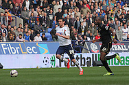 Bolton Wanderer's goalscorer Lukas Jutkiewicz competes for the ball against Wigan's captain Emmerson Boyce. Skybet football league championship match , Bolton Wanderers v Wigan Athletic at the Reebok stadium in Bolton on Saturday 29th March 2014.<br /> pic by David Richards, Andrew Orchard sports photography.