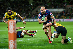 March 30, 2018 - Melbourne, Australia - Billy Meakes of the Melbourne Rebels  is tackled by Jordie Barrett of the Wellington Hurricanes  during Round 7 of the Super Rugby Series between the Melbourne Rebels and the Wellington Hurricanes at AAMI Park in Melbourne. (Credit Image: © Jason Heidrich/Icon SMI via ZUMA Press)