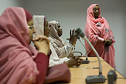 Women of the Sudanese Womens' General Union activity project in central Khartoum speak at a public meeting.