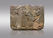 Picture & image of Hittite monumental relief sculpted orthostat stone panel of Procession. Basalt, Karkamıs, (Kargamıs), Carchemish (Karkemish), 900 - 700 B.C. Goddess Kubaba. Anatolian Civilisations Museum, Ankara, Turkey.<br /> <br /> Procession for. There are four figures on the other face of the orthostat. The leftmost figure plays a pipe, while the other three figures play the drums. All of the figures have long skirts and same body heights.  <br /> <br /> Against a gray background. .<br />  <br /> If you prefer to buy from our ALAMY STOCK LIBRARY page at https://www.alamy.com/portfolio/paul-williams-funkystock/hittite-art-antiquities.html  - Type  Karkamıs in LOWER SEARCH WITHIN GALLERY box. Refine search by adding background colour, place, museum etc.<br /> <br /> Visit our HITTITE PHOTO COLLECTIONS for more photos to download or buy as wall art prints https://funkystock.photoshelter.com/gallery-collection/The-Hittites-Art-Artefacts-Antiquities-Historic-Sites-Pictures-Images-of/C0000NUBSMhSc3Oo
