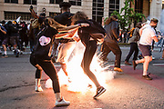 A conclusive grenade thrown by police explodes at the feet of protestors during clashes after the death of George Floyd at the hands of Minneapolis Police in Washington, D.C. on May 31, 2020.