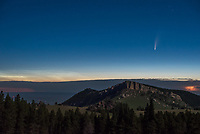 All night long lightning flashed to the north over Steamboat Point in the Bighorn Mountains. Then at 2:30AM Comet C/2020 F3 NEOWISE rose above the horizon. Finally as the first light of dawn came, noctilucent clouds appeared. It was the brightest display I've ever seen. Seeing all these things at the same time made it a night to remember.