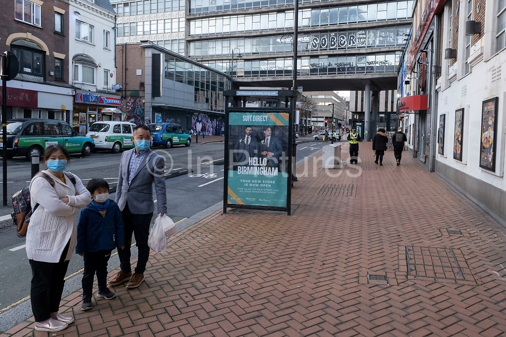 With local coronavirus lockdown measures in place and Birmingham currently set at 'Tier 2' or 'high', wearing face masks, come to Chinese Quarter in the city centre on 26th October 2020 in Birmingham, United Kingdom. The three tier system in the UK has levels: 'medium', which includes the rule of six, 'high', which will cover most areas under current restrictions; and 'very high' for those areas with particularly high case numbers. Meanwhile there have been calls by politicians for a 'circuit breaker' complete lockdown to be announced to help the growing spread of the Covid-19 virus.