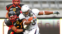 10.07.2011, Tivoli Stadion, Innsbruck, AUT, American Football WM 2011, Group A, Germany (GER) vs United States of America (USA), im Bild tackle from Oliver Radke (Germany, #27, DB) against Da'Shawn Thomas (USA, #28, RB)   // during the American Football World Championship 2011 Group A game, Germany vs USA, at Tivoli Stadion, Innsbruck, 2011-07-10, EXPA Pictures © 2011, PhotoCredit: EXPA/ T. Haumer