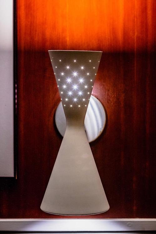 A Mid-Mentury modern, wall-mounted light fixture