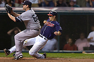 David Richard/MLB.com.Cleveland base runner Grady Sizemore scores a run on a wild pitch by New York's Joba Chamberlain in the eighth inning of Game 2 of the 2007 ALDS at Jacobs Field in Cleveland.