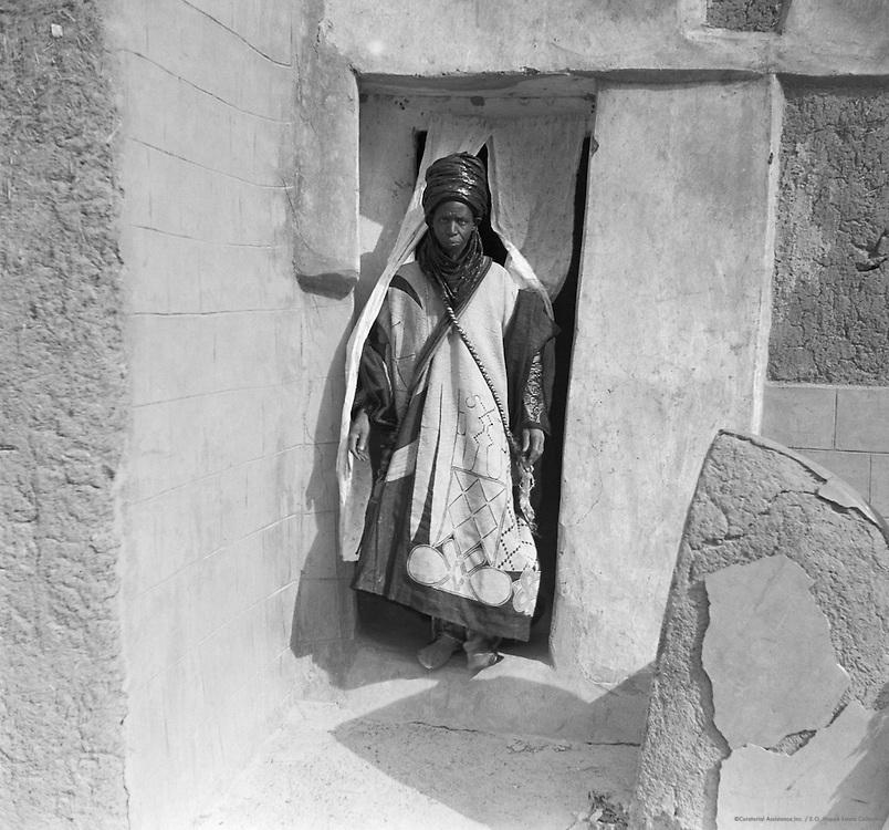 Mallam Dogo Exiting House, Yelwa, near Zaria, Nigeria, Africa, 1937