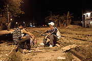 Migrants wait for the arrival of the train in Tenosique, Tabasco, during the night. (Photo: Prometeo Lucero)