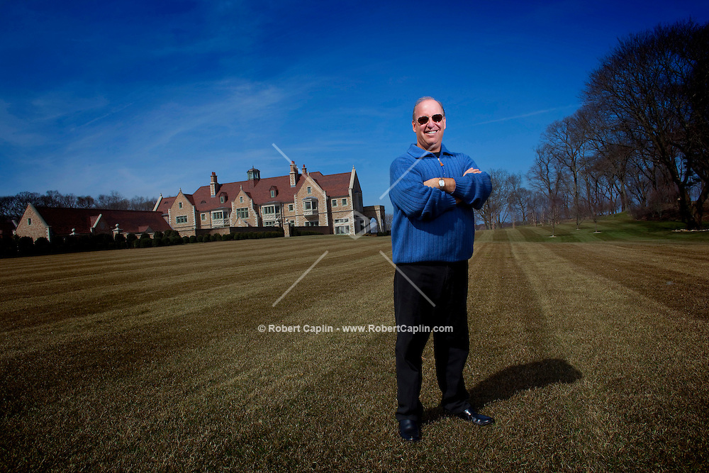 Steven Schonfeld stands outside his newly built home.