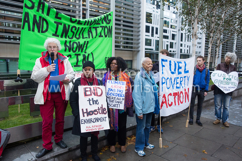 London, UK. 17 October, 2019. Ruth London addresses fellow campaigners from Fuel Poverty Action (FPA), residents in uninsulated homes and climate activists protesting outside the Ministry of Housing, Communities and Local Government (MHCLG) before delivering a letter signed by FPA, 80 organisations, trade unions and MPs in just ten days precisely one year after a strongly worded letter about the urgency of recladding flammable buildings and insulating those that are cold was delivered to the Government department. Commitments made by the MHCLG in response to the original letter have not been met. Credit: Mark Kerrison/Alamy Live News