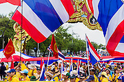 """09 MAY 2014 - BANGKOK, THAILAND: Anti-government protestors jam Ratchadamnoen Ave on the west side of Government House in Bangkok. Thousands of Thai anti-government protestors took to the streets of Bangkok Friday to start their """"final push"""" to bring the popularly elected of government of Yingluck Shinawatra. Yingluck has already been forced out by a recent court ruling that forced her to resign and she is facing indictment by the National Anti Corruption Commission of Thailand for alleged improprieties related to a government rice price support scheme. The protestors Friday were marching to demand that she not be allowed to return to politics. The courts have not banned her party, Pheu Thai, which has formed an interim caretaker government to govern until elections expected in July, 2014. Suthep Thaugsuban, secretary-general of the People's Democratic Reform Committee (PDRC),  said the president of the Supreme Court and the new senate speaker, who would be selected Friday, should set up an """"interim people's government and legislative assembly."""" He went onto say that if they didn't, he would.     PHOTO BY JACK KURTZ"""