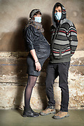young couple portrait with woman pregnant during the Covid-19
