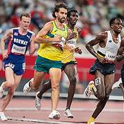 TOKYO, JAPAN August 3:   Morgan McDonald of Australia, Isaac Kimeli of Belgium and Jamal Abdelmaji Eisa Mohammod of the Refugee Olympic Team in action during the Men's 5000m round one heat two race at the Olympic Stadium during the Tokyo 2020 Summer Olympic Games on August 3rd, 2021 in Tokyo, Japan. (Photo by Tim Clayton/Corbis via Getty Images)