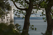 Seascape with Miramare Castle and Adriatic Sea under cloudy sky, Trieste, Italy
