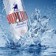 Soplica vodka bottle falling into liquid base creating sculptural horses formed by the splashes Ray Massey is an established, award winning, UK professional  photographer, shooting creative advertising and editorial images from his stunning studio in a converted church in Camden Town, London NW1. Ray Massey specialises in drinks and liquids, still life and hands, product, gymnastics, special effects (sfx) and location photography. He is particularly known for dynamic high speed action shots of pours, bubbles, splashes and explosions in beers, champagnes, sodas, cocktails and beverages of all descriptions, as well as perfumes, paint, ink, water – even ice! Ray Massey works throughout the world with advertising agencies, designers, design groups, PR companies and directly with clients. He regularly manages the entire creative process, including post-production composition, manipulation and retouching, working with his team of retouchers to produce final images ready for publication.