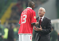 """PORTUGAL - LISBOA 08 JANUARY 2005: ALCIDES #13 and Benfica coach GEOVANI  TRAPATTONI in the 16¼ leg of the Super Liga, season 2004/2005, match  Sporting CP vs SL Benfica (2 - 1), held in """"Alvalade XXI"""" stadium,  08/01/2005  22:28:41<br />(PHOTO BY: NUNO ALEGRIA/AFCD)<br /><br />PORTUGAL OUT, PARTNER COUNTRY ONLY, ARCHIVE OUT, EDITORIAL USE ONLY, CREDIT LINE IS MANDATORY<br /> AFCD-PHOTO AGENCY 2005 © ALL RIGHTS RESERVED"""
