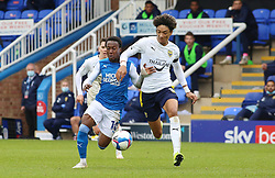 Siriki Dembele of Peterborough United in action with Sean Clare of Oxford United - Mandatory by-line: Joe Dent/JMP - 17/10/2020 - FOOTBALL - Weston Homes Stadium - Peterborough, England - Peterborough United v Oxford United - Sky Bet League One