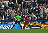 Photo: Andrew Unwin.<br /> Newcastle United v Bolton Wanderers. The Barclays Premiership. 15/10/2006.<br /> Bolton's El-Hadji Diouf (#21) celebrates his first goal in front of the Newcastle supporters.