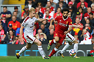 Mohamed Salah of Liverpool is chased by Ben Mee of Burnley. Premier League match, Liverpool v Burnley at the Anfield stadium in Liverpool, Merseyside on Saturday 16th September 2017.<br /> pic by Chris Stading, Andrew Orchard sports photography.