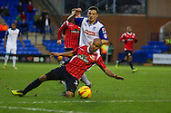 Walsall's Adam Chambers is challenged by Tranmere Rovers Jason Koumas. Skybet football league 1 match, Tranmere Rovers v Walsall at Prenton Park in Birkenhead, England on Saturday 11th Jan 2014.<br /> pic by Chris Stading, Andrew Orchard sports photography.