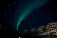 Chasing the Northern Lights. Ersfjord, Kvaløya (Whale Island). Image taken with a Nikon 1 V2 camera and 10 mm f/2.8 fisheye lens (ISO 1600, 16 mm, f/2.8, 15 sec).
