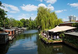 Bars on  Flutgraben Canal Club der Visionare Freischwimmer restaurant on left in Kreuzberg, Berlin, Germany