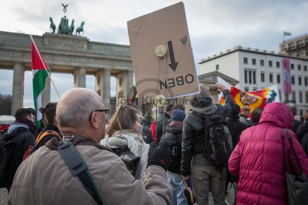 """Berlin, Germany - 08.02.2019<br /> <br /> """"Hands off Venezuela""""-rally, at the Brandenburg Gate in Berlin, to support the president of Venezuela Nicolas Manduro<br /> <br /> """"Hands off Venezuela""""-Kundgebung zur Unterstuetzung von Nicolas Manduro, dem Praesidenten von Venezuela am Brandenburger Tor in Berlin.<br /> <br /> Photo: Bjoern Kietzmann"""