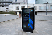 HM Government, and NHS advertising boards advise regular hand washing to help prevent Coronavirus contamination in Birmingham city centre is virtually deserted due to the Coronavirus outbreak on 31st March 2020 in Birmingham, England, United Kingdom. Following government advice most people are staying at home leaving the streets quiet, empty and eerie. Coronavirus or Covid-19 is a new respiratory illness that has not previously been seen in humans. While much or Europe has been placed into lockdown, the UK government has announced more stringent rules as part of their long term strategy, and in particular social distancing.