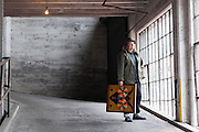 Longtime Portland resident Matt Wagner, curator, author (of the book series The Tall Trees of Portland, Tokyo and Paris), and beer rep for Gigantic Brewing is photographed holding a piece from local artist AJ Fosik's collection. <br /> Image by Shauna Intelisano