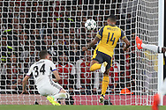 GOAL - Theo Walcott of Arsenal heads the ball to score his sides 1st goal of the match to make it 1-0. UEFA Champions league group A match, Arsenal v FC Basel at the Emirates Stadium in London on Wednesday 28th September 2016.<br /> pic by John Patrick Fletcher, Andrew Orchard sports photography.