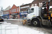 Snow plough out cleatring roads in Kings Heath head out to enjoy the heavy snow fall on Sunday 10th December 2017 in Birmingham, United Kingdom. Deep snow arrived in much of the UK, closing roads and making driving treacherous, while many people simply enjoyed the weather.