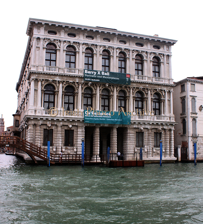 The Ca' Rezzonico. A palazzo in the Baroque style on the Grand Canal in Venice, Italy. Designed by Baldassarre Longhena in the late 17th century, but completed by Giorgio Massari in 1756. Now it is one of the 11 museums run by the Fondazione Musei Civici di Venezia system.