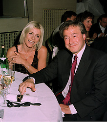THE MINISTER FOR SPORT TONY BANKS MP and actress MICHELLE COLLINS at a party in London on 9th June 1997.LZD 11