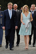 The Dutch prince Willem-Alexander (R) and his wife princess Maxima walk in front of Castle Duivenvoorde in Voorschoten, The Netherlands on 28 April 2010. The royal couple opened the exhibit Tijdloos Trendy (Forever Trendy). The exhibit is one of the activities of the 50th anniversary of the Duivenvoorde foundation. <br /> <br /> On the Photo:  Willem Alexander and Maxima