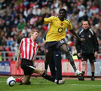 Photo: Andrew Unwin.<br /> Sunderland v Arsenal. The Barclays Premiership. 01/05/2006.<br /> Sunderland's Jonathan Stead (L) looks to tackle Arsenal's Emmanuel Adebayor (C).