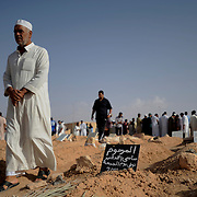 Locals attend a funeral, in Zintan, of a rebel fighter killed earlier in the day during clashes with the Libyan army.