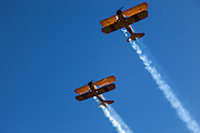 Two PT-17 Stearman Kaydets fly over the 2014 Hood River Fly-In at WAAAM.