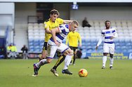 Queens Park Rangers defender Jake Bidwell (3) battles for possesion with Burton Albion defender Tom Flanagan (2) during the EFL Sky Bet Championship match between Queens Park Rangers and Burton Albion at the Loftus Road Stadium, London, England on 28 January 2017. Photo by Matthew Redman.