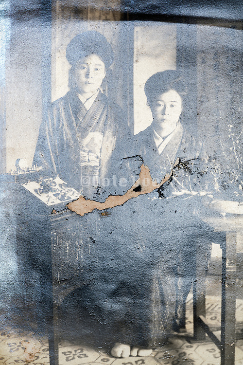 extreme eroding and damaged portrait of two girls posing with modern electronic equipment Japan ca 1930s