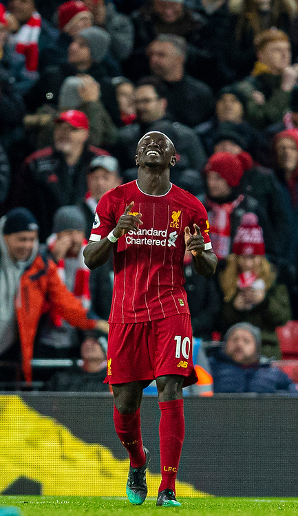 LIVERPOOL, ENGLAND - Wednesday, December 4, 2019: Liverpool's Sadio Mané celebrates after scoring the fourth goal during the FA Premier League match between Liverpool FC and Everton FC, the 234th Merseyside Derby, at Anfield. Liverpool won 5-2. (Pic by David Rawcliffe/Propaganda)