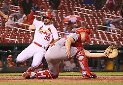 September 12, 2017 - St Louis, MO, USA - The St. Louis Cardinals' Greg Garcia, left, scores on a double by Matt Carpenter as Cincinnati Reds catcher Stuart Turner receives the throw in the seventh inning on Tuesday, Sept. 12, 2017, at Busch Stadium in St. Louis. The Cards won, 13-4. (Credit Image: © Chris Lee/TNS via ZUMA Wire)