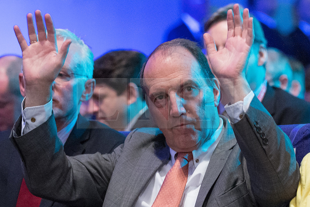 © Licensed to London News Pictures . 08/10/2014 . Glasgow , UK . SIMON HUGHES waves his hands in the air in silent applause for Tim Farron ahead of Deputy Prime Minister and Party Leader , Nick Clegg , delivering his keynote speech at the close of the conference . The Liberal Democrat Party Conference 2014 at the Scottish Exhibition and Conference Centre in Glasgow . Photo credit : Joel Goodman/LNP