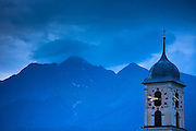 Nighttime scene of traditional church in the Swiss Alps, Graubunden region of Eastern Switzerland