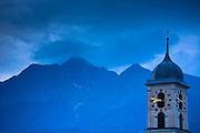 Nighttime scene of traditional church in the Swiss Alps, Graubunden region of Eastern Switzerland
