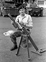 Colonel Malcolm Mackenzie-Orr, RAOC, Royal Army Ordnance Corps, demonstrating a Provisional IRA DIY rocket launcher captured in a planned search in Belfast, N Ireland, UK. The weapon was constructed from lavatory pipes and joints as used by plumbers. A few months later Mackenzie-Orr defused a massive van bomb beside a Belfast telephone exchange for which he was awarded the George Cross. After he had foiled the attempt to destroy the exchange, it was feared he might become a terrorist target and he was re-assigned to the weapons research establishment in Woomera, South Australia. He left the military having achieved the rank of brigadier. He died 16th December 2007 in Australia. 197307050472b.<br /> <br /> Copyright Image from Victor Patterson, 54 Dorchester Park, Belfast, UK, BT9 6RJ<br /> <br /> t1: +44 28 9066 1296 (from Rep of Ireland 048 9066 1296)<br /> t2: +44 28 9002 2446 (from Rep of Ireland 048 9002 2446)<br /> m: +44 7802 353836<br /> <br /> e1: victorpatterson@me.com<br /> e2: victorpatterson@gmail.com<br /> <br /> The use of my copyright images is subject to my Terms & Conditions.<br /> <br /> It is IMPORTANT that you familiarise yourself with them. They are available on my website at www.victorpatterson.com.<br /> <br /> None of my copyright images may be used on a website unless they are visibly watermarked, i.e. © Victor Patterson within the body of the visible image. Metadata denoting my copyright must NOT be deleted. <br /> <br /> Web use (maximum size - 400 kb) is extra at currently recommended NUJ rates.