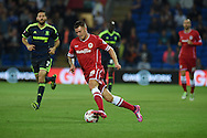 Anthony Pilkington of Cardiff city © makes a break. Skybet football league championship match, Cardiff city v Middlesbrough at the Cardiff city stadium in Cardiff, South Wales on Tuesday 16th Sept 2014<br /> pic by Andrew Orchard, Andrew Orchard sports photography.