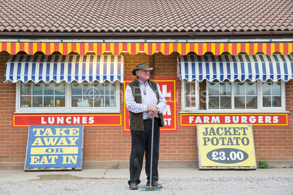 Bill, the owner of the Farm Cafe in rural Holbeach on the 23rd June 2017 in Norfolk, United Kingdom. Established during the 1950's after the owners parents set up a tea stop on the east bound A17, the cafe has grown over the years and attracts coach loads of tourist and travellers often en route to the north Norfolk coast.