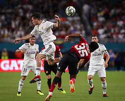 July 31, 2018 - Miami Gardens, Florida, USA - Real Madrid C.F. defender Sergio Lopez (31) (left) disputes the ball with Manchester United F.C. midfielder Demetri Mitchell (35) (right) during an International Champions Cup match between Real Madrid C.F. and Manchester United F.C. at the Hard Rock Stadium in Miami Gardens, Florida. Manchester United F.C. won the game 2-1. (Credit Image: © Mario Houben via ZUMA Wire)